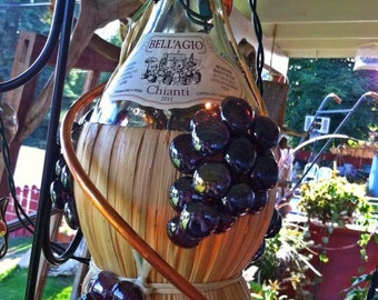 Hanging Italian Chianti lights wrapped in copper!