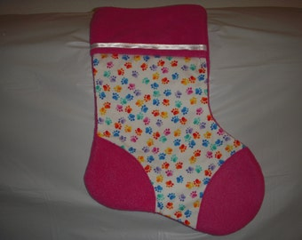 Pet Christmas Stocking - multi-colored paws cotton print with pink fleece on the heel, toe and cuff.