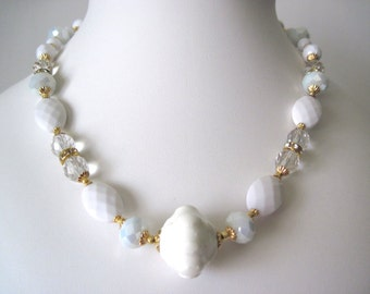 White and gold necklace.  Chunky style, great for summer.