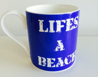 "Bone china mug with ""Life's a beach"" design"