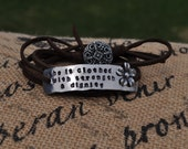 She is clothed with strength and dignity wrap bracelet