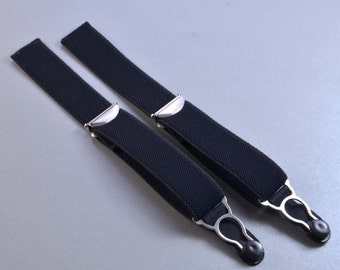 Suspenders with garter belt clip for attaching to black.