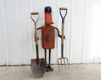 Gardener's Gentleman welded garden art and storage