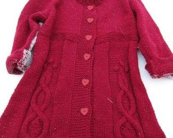 Red handknitted girls coat