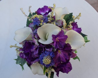 Bridesmaid bouquet in shades of purple and white real touch calla lilies