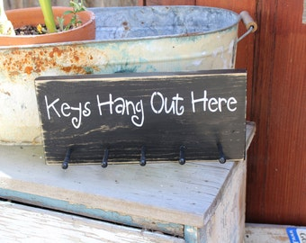 Keys hang out here wooden key rack
