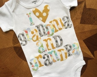 I heart grandma and grandpa appliqued onesie in gray, mustard yellow and multicolor pastels