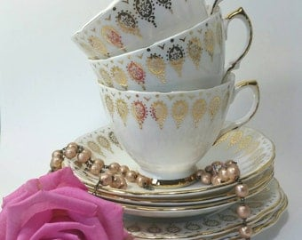 Vintage teacup trio made by royal vale in gold and white.