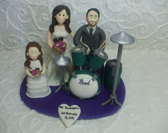 custom bride and groom with drums wedding cake topper