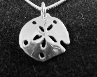Sandollar necklace dime size w/sterling silver chain