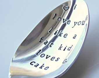I love you like a fat kid loves cake! Tell your sweetheart you love them with this cute, I love you spoon.