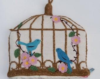 Golden bird cage tea cosy