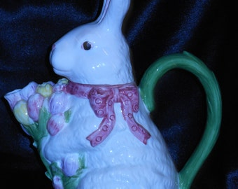 Easter Bunny Beverage Pot Holding Bouquet Of Tulips For The Spout.