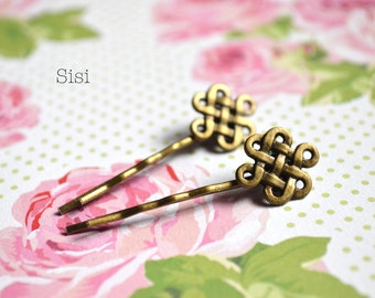 Pair of bronze knot hair barrettes