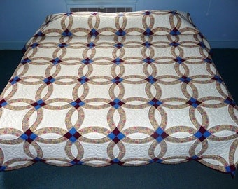 Traditional Amish Double Wedding Ring Quilt in Tan Calico with Blue accents