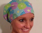 Flowers in greens, blues and violet.  Surgical hat, euro style with adjustable elastic closure.