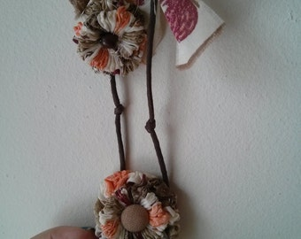 Handmade Wax cord necklace with yoyo flowers