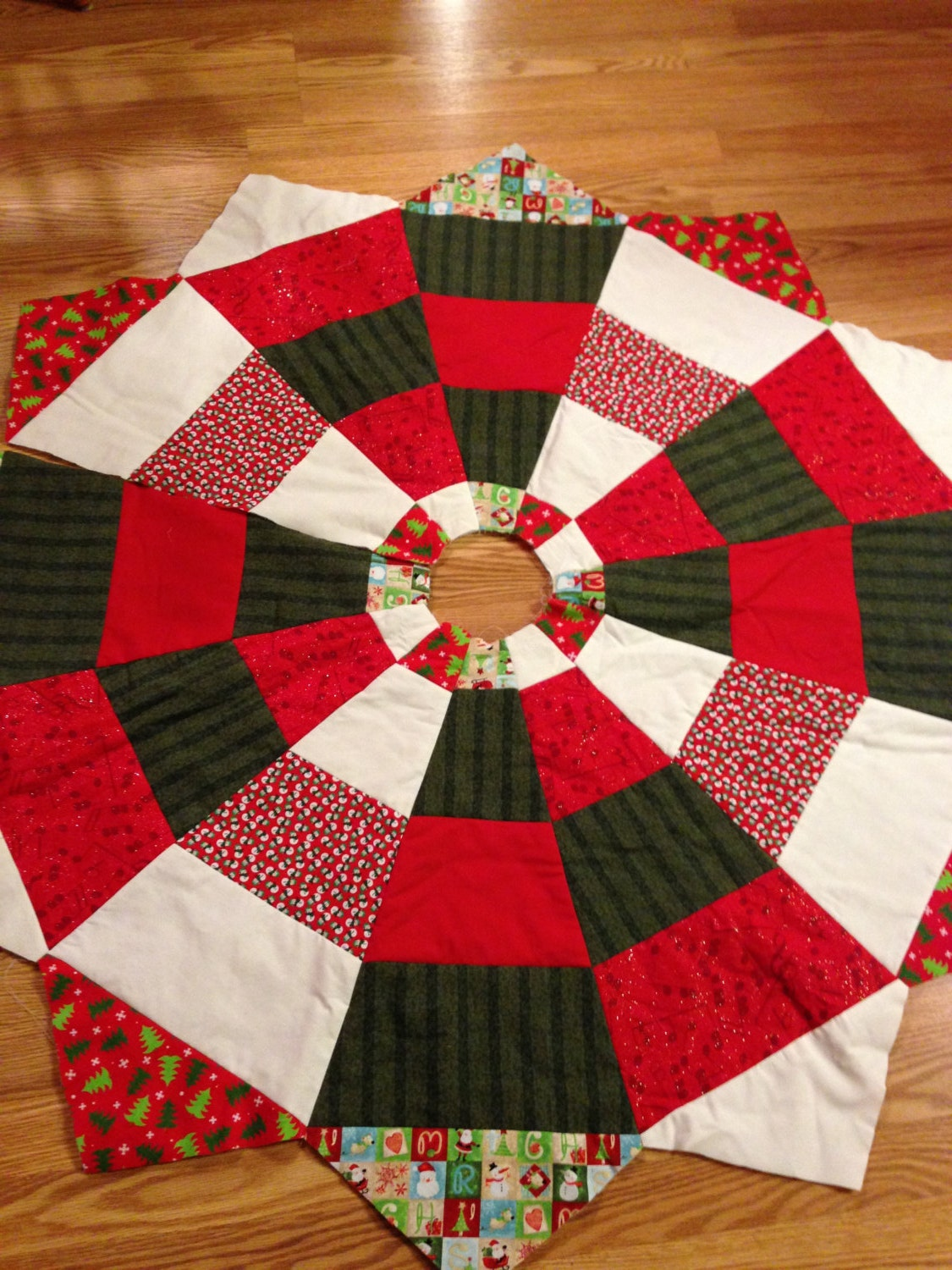 Homemade quilted christmas tree skirt red green off