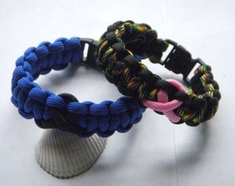 2 paracord bracelets, with cancer awareness symbols