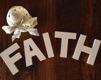 Written FAITH in wood