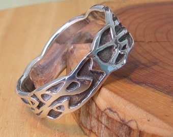 A silver ring with decorative design.