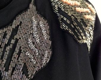 Black dress, pearls, 80 years