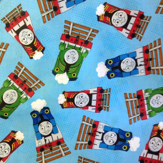 One half yard of fabric material thomas the train toss for Train fabric by the yard