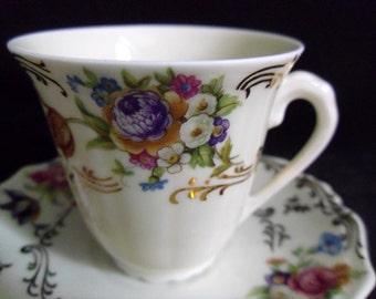 French Limoges cup and saucer set White porcelain Elegant flower design 24k gold trim Jammet Seignolles Exclusivite