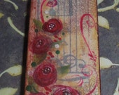 Handpainted Domino that has music tape that is subtly in the background, Red Roses have been hand painted on top of the tape, Magnet, Gift