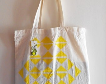 Bag Tote Bag geometric with yellow triangle.