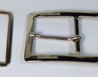 2 twin buckless in silver-plated metal. 88 mm X 54 mm.
