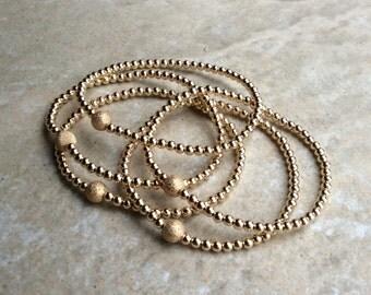 Set of five gold filled stretchy beaded bracelet