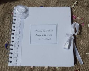 Wedding guest book. White wedding guest book.