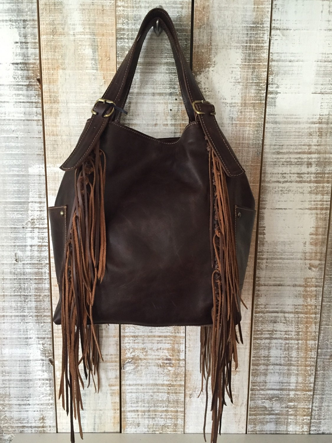 You searched for: brown leather fringe bag! Etsy is the home to thousands of handmade, vintage, and one-of-a-kind products and gifts related to your search. No matter what you're looking for or where you are in the world, our global marketplace of sellers can help you .