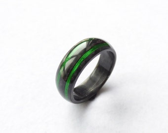 carbon fiber ring & green wire lines
