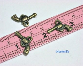 "Lot of 24pcs Antique Bronze Tone ""Pistol"" Double Sided Metal Charms. #BC3778."