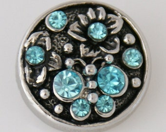 Blue Crystal Flowers and Accents on a Black Enamel Background