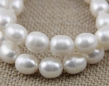 11mm large drop pearl strand,white color freshwater oval pearl strand,rice pearl,large hole pearls,1.0mm,1.5mm,1.8mm,2.0mm,2.2mm,2.5mm,3.0mm