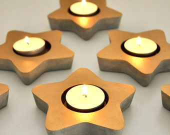 Star candle holder gold cement. Concrete candle.