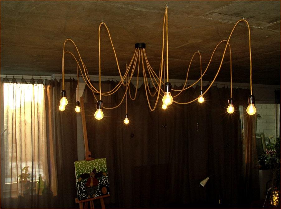 Golden chandelier with twelve textile cables. Ceiling octopus