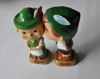 Austrian Bayer boy and girl kissing bobble heads