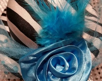 blue and black top hat on clips