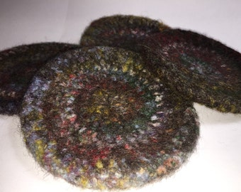 Crochet coasters in brown and varigated colors