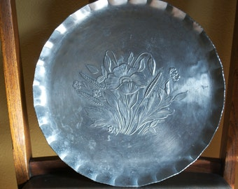 Everlast hand forged, hammered aluminum serving tray with a floral design.  Crimped serrated edge.  Circa 1950's