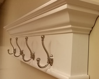 Architectural shelf with coat hooks