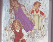 Vintage Simplicity girl's jumper and blouse pattern in size 7. AS IS