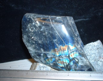 A Labradorite end cut that has been polished on two sides an excellent lapidary material from Labrador