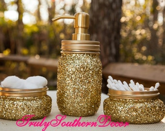 Gold glitter bathroom set. One pint jar soap dispenser and two accessory jars.