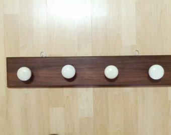 reclaimed black walnut with white marble vintage door knobs!