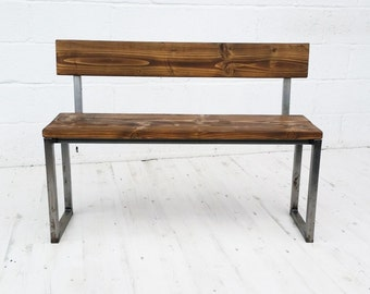 Vintage industrial bench with back.
